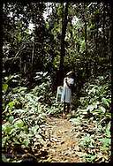 Rubber tapper's daughter looks @ trees on hour walk thru jungle to school; Seringal Cachoeira,AC Brazil