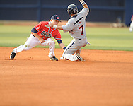 Mississippi's Alex Yarbrough (2) tags out Auburn's Trent Mummey (7) on a steal attempt during a college baseball game in Oxford, Miss. on Thursday, May 20, 2010.  (AP Photo/Oxford Eagle, Bruce Newman)