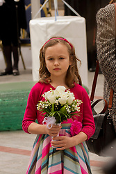 © Licensed to London News Pictures. 02/05/2012. Exeter, UK. A young girl holds a posy of flowers to present to Queen Elizabeth II during her Diamond Jubilee Tour visit to Princesshay, Exeter. Photo credit : Ashley Hugo/LNP