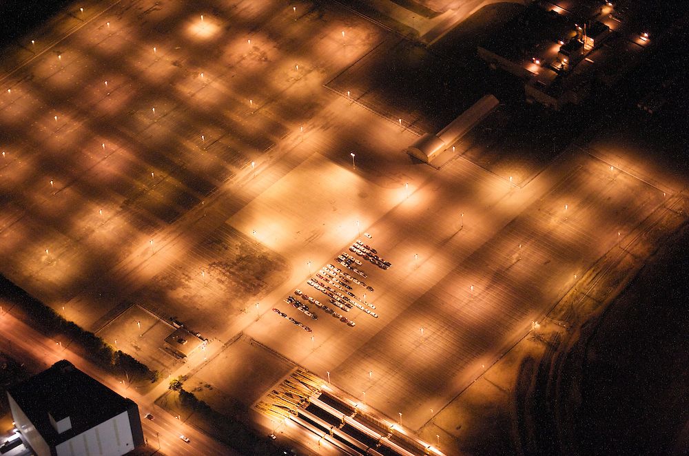 Detroit from the air at night with lights on an empty parking lot.