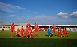 NEWPORT, WALES - Tuesday, June 12, 2018: Wales players line-up for a team group photograph before FIFA Women's World Cup 2019 Qualifying Round Group 1 match between Wales and Russia at Newport Stadium. L-R Kayleigh Green, Helen Ward, Hayley Ladd, Loren Dykes, captain Sophie Ingle, Angharad James, Rachel Rowe, goalkeeper Laura O'Sullivan, Rhiannon Roberts, Jessica Fishlock, Natasha Harding. (Pic by David Rawcliffe/Propaganda)