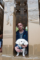 20/07/2018 repro free:  How much is that doggiie in the window.... Sweeney dog from Lackagh with human Jack Taylor  at The People Build at Galway International Arts Festival will see hundreds of volunteers, and the general public, create two large-scale and highly ambitious structures solely from cardboard. Under the guidance of artist Olivier Grossetete and his team, the public will transform thousands of cardboard boxes into a structure to replicate St. Nicholas&rsquo; Church in Galway. It is being constructed on Eyre Square in Galway today. On Sunday July 22 at 6pm the public will join forces in a massive celebratory demolition, which will see the cardboard building come tumbling down. <br /> <br /> A second structure will consist of a cardboard bridge being built at Waterside in Galway. It will be floated on the water, serving as a testimony to Galway&rsquo;s River Corrib Viaduct, once part of the famous Galway to Clifden Railway. The build will take place on Saturday July 21 and will be demolished on Sunday July 22 at 3pm. <br />  . Photo:Andrew Downes, XPOSURE