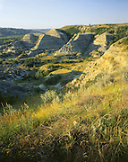 AA02182-04...NORTH DAKOTA - Banded clay buttes near Oxbow Overlook in Theodore Roosevelt National Park.