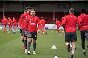 Neal Eardley of Lincoln City warms up with his team mates during the EFL Sky Bet League 2 match between Swindon Town and Lincoln City at the County Ground, Swindon, England on 12 January 2019.