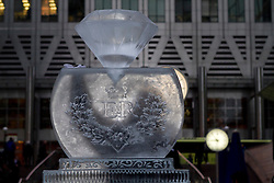 © Licensed to London News Pictures. 12/01/2012. London, UK. The London Ice Sculpting Festival has created a giant Jubilee diamond from ice in Canary Wharf's Reuters Plaza to celebrate the Queen's diamond jubilee this year. Photo credit : James Gourley/LNP