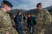 Image shows LtoR: Sapper Fieldhouse, 15 Psychological Operations Group and Sargeant Smith, Military Stabilisation &amp; Support Group with children from Camil Sijaric School, in the village of Nemila. 16/03/2015<br /> <br /> Credit should read: Cpl Mark Larner, Media Ops Group<br /> <br /> Exercise Civil Bridge is an exercise in support of UK Defence Engagement by elements of 77 Brigade. Civil Bridge 14B (CB14B) is being conducted Sarajevo, Bosnia &amp; Herzegovina (BiH).<br /> <br /> By assisting the BiH Government to develop their contingency plans for natural disasters at both strategic and operational levels, CB14B will contribute to the long term international effort to stabilise BiH ethnic groups and authorities.