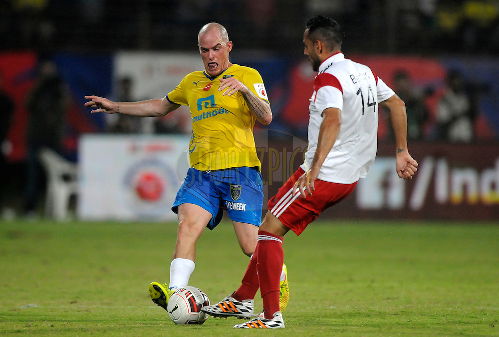 Leo Bertos of NorthEast United FC and Iain Hume of Kerala Blasters FC during match 49 of the Hero Indian Super League between Kerala Blasters FC and North East United FC held at the Jawaharlal Nehru Stadium, Kochi, India on the 30th November.<br /> <br /> Photo by:  Pal Pillai/ ISL/ SPORTZPICS
