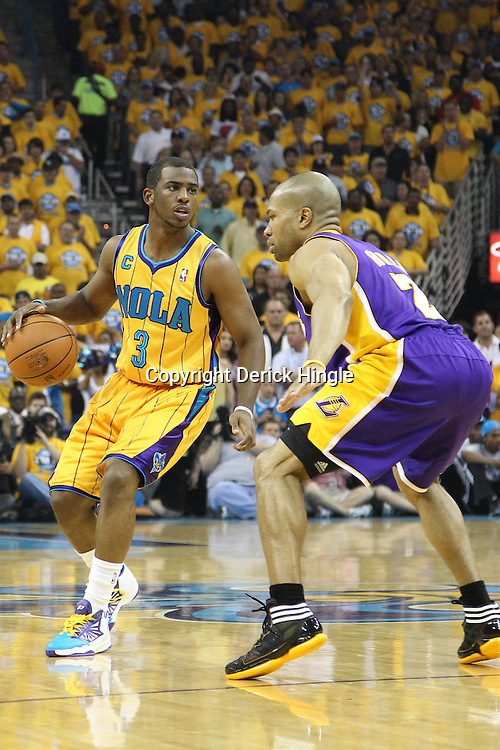 April 22, 2011; New Orleans, LA, USA; New Orleans Hornets point guard Chris Paul (3) is guarded by Los Angeles Lakers point guard Derek Fisher (2) during the first quarter in game three of the first round of the 2011 NBA playoffs at the New Orleans Arena.    Mandatory Credit: Derick E. Hingle