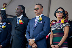 (L-R) Senator Positive T. A. Nelson raises a fist and sheds a tear during the Black National Anthem with Senators Jean A. Forde, and Nereida Rivera-O'Reilly.  St. Thomas Swearing-In Ceremony for the 32nd Legislature of the US Virgin Islands.  Emancipation Garden.  St. Thomas, VI.  9 January 2017.  © Aisha-Zakiya Boyd