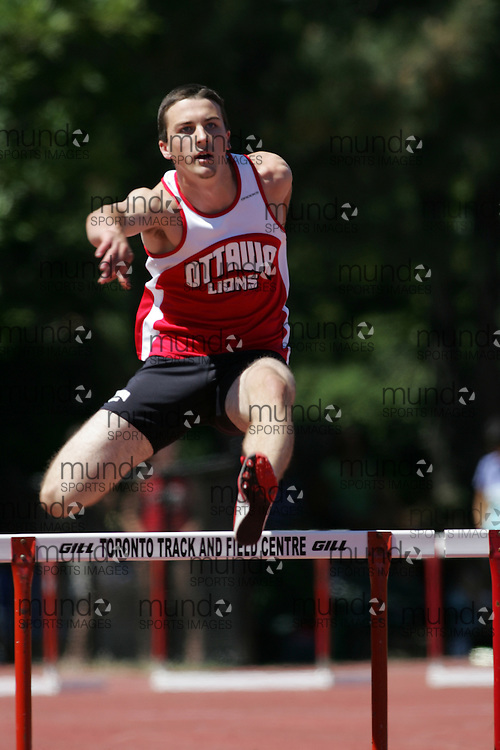 Eric Leclerc running the 200m hurdles at the 2007 OTFA Supermeet II. The Ontario Track and Field Association Bantam-Midget-Juvenile Championships were held in Toronto from August 3rd to 5th.