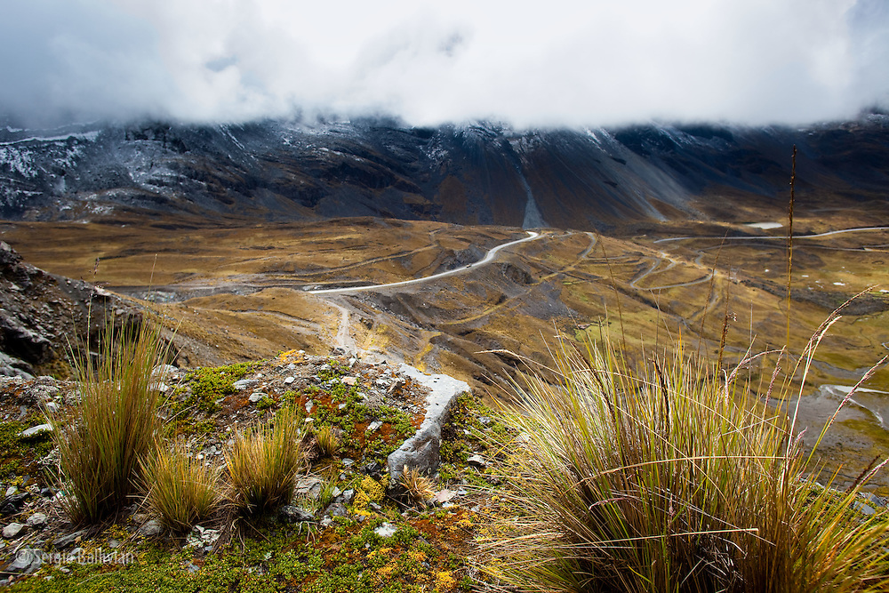 The road from the Cumbre Pass winds its way down to the Yungas region near La Paz, Bolivia.  The Andes mountains loom high above the two-lane road as it carves it's way through the Cordillera Real.