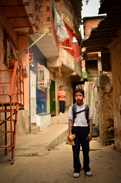 A student from the José Martí primary school in Sarría, a slum in Caracas, Venezuela, walks home from school. The El Sistema program built a nucleo for it's classical music education program in this neighborhood.
