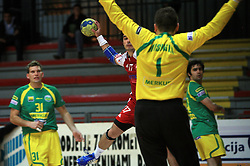 Peter Hrvatin of Slovan vs goalkeeper Petar Misovski at handball game RD Slovan vs RD Merkur  in 7th round of MIK First league, on October 24, 2008 in Ljubljana, Slovenia. (Photo by Vid Ponikvar / Sportal Images)