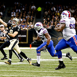 Oct 27, 2013; New Orleans, LA, USA; New Orleans Saints quarterback Drew Brees (9) throws as Buffalo Bills outside linebacker Jerry Hughes (55) pressures during the first half of a game at Mercedes-Benz Superdome. Mandatory Credit: Derick E. Hingle-USA TODAY Sports