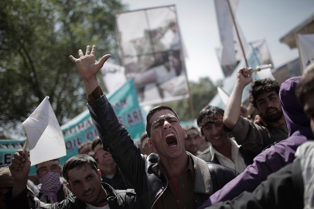 APOCALYPSE AFGHANISTAN - Afghan protestors shout slogans against Iranian President Mahmoud Ahmadinejad during a demonstration in front of the Iranian embassy compound in Kabul on May 2, 2010. Some 200 people gathered in the protest during which they accused the Iranian government  of a public execution of 40 Afghans two weeks ago. AFP PHOTO/Mauricio LIMA