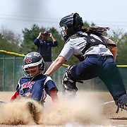 Goldey-Beacom Catcher Alivia Schoff (7) attempts to tag Nyack outfielder Anna Bailey (4) at home plate during a NCAA Central Atlantic Collegiate Conference game between Nyack College and Goldey-Beacom Saturday, April 19, 2014, at Nancy Churchmann Sawin Athletic Field in Wilmington Delaware.<br />