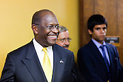 17 OCTOBER 2011 - PHOENIX, AZ:   HERMAN CAIN, a Republican candidate for US President, walks into a conference room for a press conference at the Maricopa County Sheriff's Office in Phoenix, AZ, Monday. Cain was in Phoenix to visit with Maricopa County Sheriff Joe Arpaio and was the featured speaker at a Republican party fundraiser.   PHOTO BY JACK KURTZ