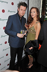 PERCY PARKER and OLIVIA GRANT at the opening of the 'pop up' Tanqueray Gin Palace hosted by Idris Elba at 13 Floral Street, Covent Garden, London on 26th March 2013.