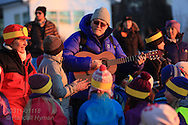 Teachers and students sing songs at return-of-the-sun celebrations at Telegrafbukta at south end of Tromsoya island on January 21st after two months with no sunrise; Tromso, Norway.