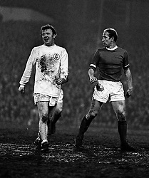 Billy Bremner of Leeds United and Bobby Charlton of Manchester United. 1st Jan 1970.