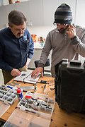 Adam Davis disucusses the deisgn of his robot with engineer Chip Clark at the Idea Lab in Zanesville. The Idea Lab provides community members as well as students access to experts and high- end specialized tools.  Photo by Ben Siegel