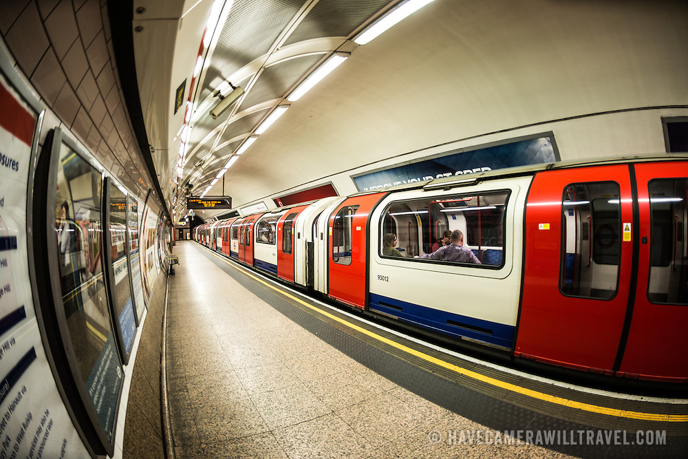 A train pulls out from a platform of a London Underground station as part of the famous subway system known as the Tube.