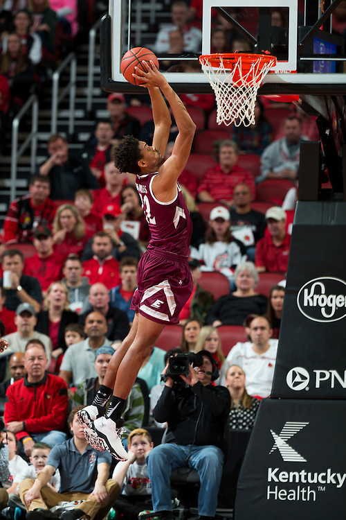 Eastern Kentucky guard Trevor Hill goes in for a dunk in the first half. The University of Louisville hosted Eastern Kentucky University, Saturday, Dec. 17, 2016 at The KFC Yum Center in Louisville.