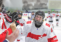 DMITROV, RUSSIA - JANUARY 10: Switzerland's Sydney Berta #5 celebrates at the bench with teammates after a first period goal against Germany during relegation round action at the 2018 IIHF Ice Hockey U18 Women's World Championship. (Photo by Steve Kingsman/HHOF-IIHF Images)