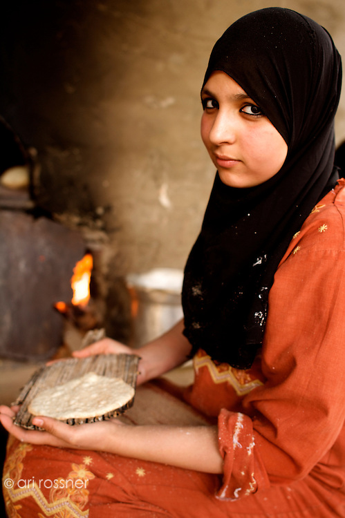 Youg woman baking pita bred
