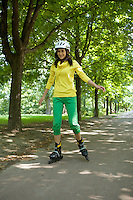 Yong woman riding roller skate