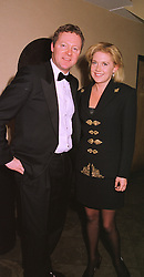 Comedian MR RORY BREMNER and MISS ZOE APPLEYARD, at a dinner in London on 1st December 1998.MMN 6