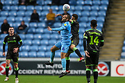Forest Green Rovers Lloyd James(4) and Coventry City midfielder Liam Kelly (6)  challenge for the ball during the EFL Trophy match between Coventry City and Forest Green Rovers at the Ricoh Arena, Coventry, England on 9 October 2018.