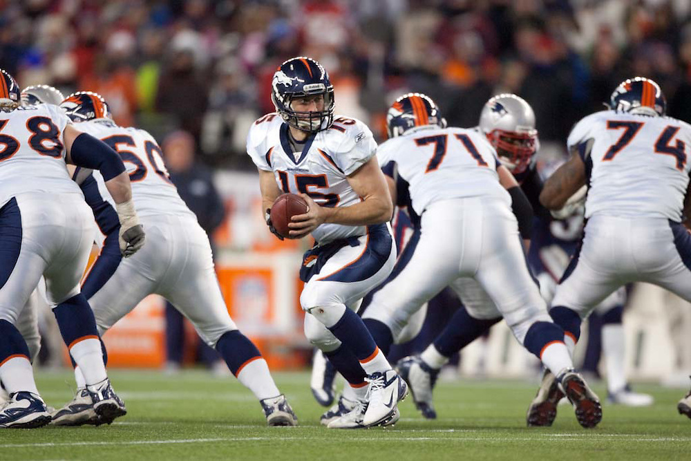 Foxborough, MA 01/14/2012.Broncos quarterback Tim Tebow scrambles in the second half of  Saturday's AFC Divisional game between the New England Patriots and the Denver Broncos..Wicked Local Photo by Alex Jones