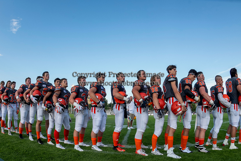 KELOWNA, BC - AUGUST 3:  The Okanagan Sun line up on the side line for the national anthem at teh start of the game against the Kamloops Broncos at the Apple Bowl on August 3, 2019 in Kelowna, Canada. (Photo by Marissa Baecker/Shoot the Breeze)