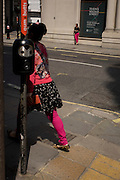 Women in pink leggings on King William Street in the City of London, the capital's Square Mile, and its financial heart.