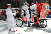 Mr. and Mrs. Met and The Good Humor Man kick off the Good Humor Summer of Joy campaign with the unveiling of The Good Humor Joy Fleet, Tuesday, June 24, 2014, in New York City.  Good Humor Pedicabs will travel the streets of New York for the next six weeks to give out joy rides and other fun surprises.  (Diane Bondareff/Invision for Good Humor/AP Images)