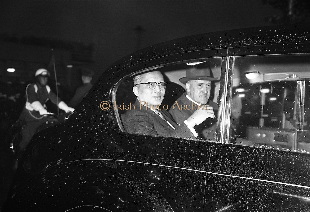 Acting Secretary-General of the U.N., U. Thant, smiles as he waves to the crowds who waited in the rain to greet him on arrival at Dublin Airport..13.07.1962