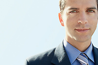 Young man wearing suit close-up portrait.