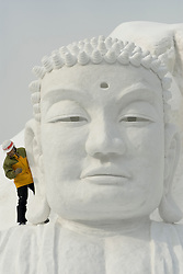 Large buddha head carved from snow at annual snow sculpture festival in Sapporo Japan