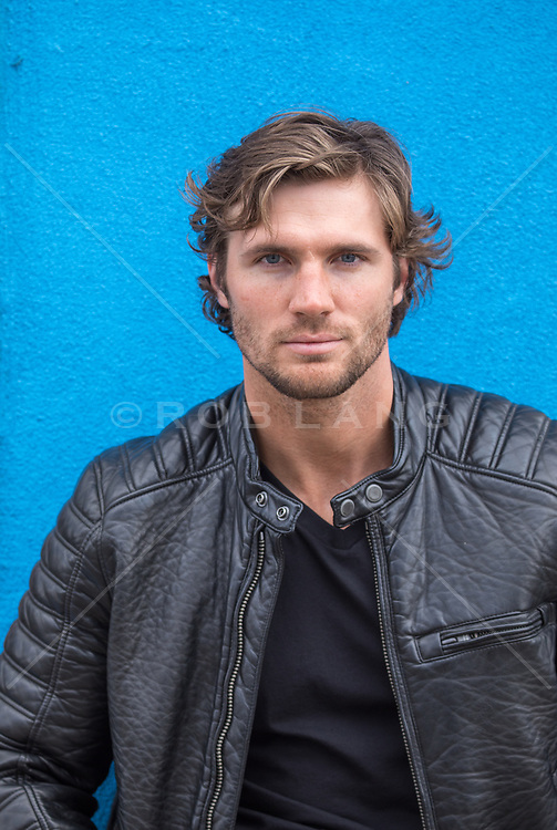 portrait of a handsome man with long brown hair and blue eyes