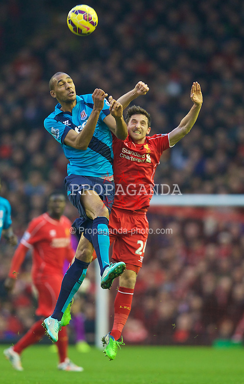 LIVERPOOL, ENGLAND - Saturday, November 29, 2014: Liverpool's Joe Allen in action against Stoke City's Steven N'Zonzi during the Premier League match at Anfield. (Pic by David Rawcliffe/Propaganda)
