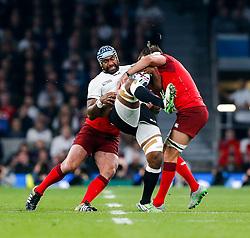 Fiji replacement Tevita Cavubati is tackled by England Prop Joe Marler and Flanker Tom Wood - Mandatory byline: Rogan Thomson/JMP - 07966 386802 - 18/09/2015 - RUGBY UNION - Twickenham Stadium - London, England - England v Fiji - Rugby World Cup 2015 Pool A.