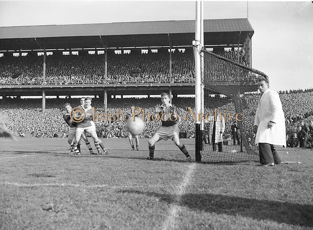 Kerry Goalie J. Culloty advances as Kerry's R. Caffey and W. Sheehy holds off Galway F Stockwell during the All Ireland Senior Gaelic Football Championship Final, Kerry vs Galway in Croke Park on the 27th September 1959. Kerry 3-7 Galway 1-4.