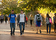 Students walk Morton Hill, a main path leading East Green to University Terrace.
