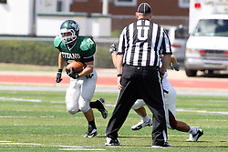 08 September 2012:  T.J. Stinde works his way to the outside during an NCAA division 3 football game between the Alma Scots and the Illinois Wesleyan Titans which the Titans won 53 - 7 in Tucci Stadium on Wilder Field, Bloomington IL