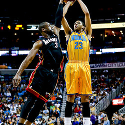Mar 29, 2013; New Orleans, LA, USA; New Orleans Hornets power forward Anthony Davis (23) shoots over Miami Heat shooting guard Dwyane Wade (3) during the first quarter of a game at the New Orleans Arena. Mandatory Credit: Derick E. Hingle-USA TODAY Sports