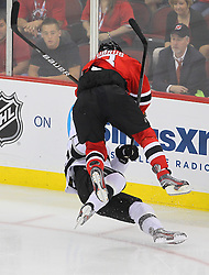 May 30; Newark, NJ, USA; New Jersey Devils right wing Dainius Zubrus (8) hits Los Angeles Kings center Jeff Carter (77) during the second period of 2012 Stanley Cup Finals Game 1 at the Prudential Center.  The Kings defeated the Devils 2-1.