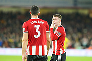 Sheffield United midfielder John Fleck (4) speaks with Sheffield United defender Enda Stevens (3) during the Premier League match between Sheffield United and Arsenal at Bramall Lane, Sheffield, England on 21 October 2019.