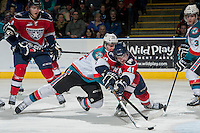 KELOWNA, CANADA - MARCH 8: Joe Gatenby #28 of the Kelowna Rockets stick checks Jessey Astles #41 of the Tri City Americans as he tries to score a goal during second period on March 8, 2014 at Prospera Place in Kelowna, British Columbia, Canada.   (Photo by Marissa Baecker/Getty Images)  *** Local Caption *** Joe Gatenby; Jessey Astles;