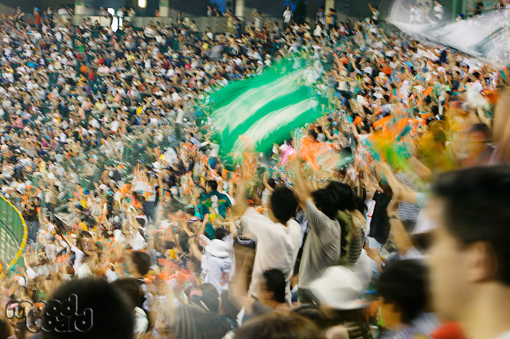 Japan Kobe Yahoo Stadium crowd of people watching baseball match motion blur